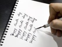 Szczęśliwa ziemskiego dnia kaligrafia i lattering Fotografia Stock