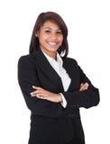 Szczęśliwe bizneswoman pozyci ręki krzyżować zdjęcie stock