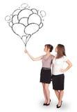 Szczęśliwe kobiety trzyma balonów rysować Fotografia Stock