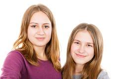 Szczęśliwe młode siostry zdjęcia stock