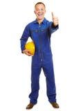 Szczęśliwe pracownika budowlanego mienia aprobaty zdjęcia stock