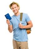 Szczęśliwego młodego turystycznego mężczyzna mienia paszportowy biały tło Zdjęcia Royalty Free