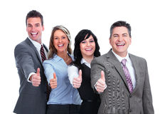 Szczęśliwi ludzie biznesu z kciukami Fotografia Stock