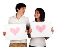 Szczęśliwi młodzi ludzie z znakami Obraz Royalty Free