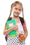 Szczęśliwi mała dziewczynka początki szkoła, portret, odizolowywający obrazy stock