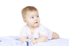 Szczęśliwi niebieskich oczu dziecka kłamstwa Obraz Royalty Free