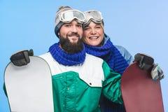 Szczęśliwi para dowcipu snowboards Obraz Royalty Free