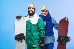 Szczęśliwi para dowcipu snowboards obraz stock