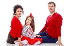 Szczęśliwi rodzice i młoda córka Fotografia Stock