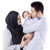 Szczęśliwi rodzice z ich dziecko dumą Zdjęcie Stock