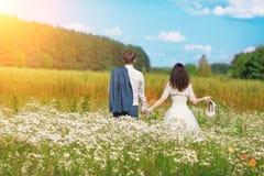 szczęśliwi weselne młodych par Zdjęcia Stock