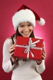 Szczęśliwy żeński mień bożych narodzeń prezent obrazy stock