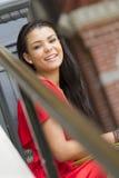 Szczęśliwy żeński nastolatka obsiadanie Obraz Stock