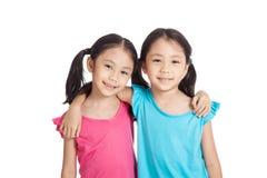 Szczęśliwy Azjatycki bliźniak dziewczyn uśmiech Obrazy Stock