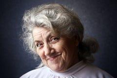 Szczęśliwy babcia portret na ciemnym tle Obraz Royalty Free