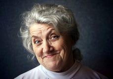 Szczęśliwy babcia portret na ciemnym tle Obrazy Royalty Free