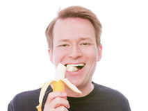 Szczęśliwy bananowy łasowanie Obrazy Stock