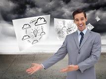 Szczęśliwy biznesmen daje prezentaci z jego rękom Fotografia Stock