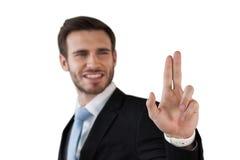 Szczęśliwy biznesmen dotyka niewidzialnego ekran Zdjęcia Royalty Free