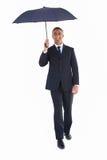 Szczęśliwy biznesmen osłania z parasolem Fotografia Stock