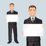 Szczęśliwy biznesmen pokazuje plakat z przestrzenią dla i wystawia twój produktu lub teksta Obrazy Stock