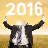 Szczęśliwy biznesmen przy polem z liczbami 2016 Zdjęcia Royalty Free