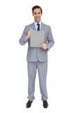 Szczęśliwy biznesmen trzyma schowek Obraz Stock