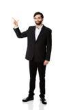 Szczęśliwy biznesmen wskazuje jego palec up obraz stock
