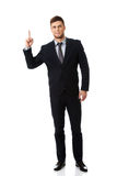 Szczęśliwy biznesmen wskazuje jego palec up obrazy royalty free