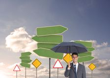 Szczęśliwy biznesmena mienia parasol Zdjęcia Royalty Free