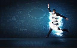 Szczęśliwy biznesowego mężczyzna doskakiwanie z burzy chmurą wokoło on zdjęcia royalty free