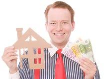 Szczęśliwy biznesowy houseowner z pieniądze zdjęcie royalty free