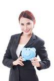Szczęśliwy bizneswomanu mienia prosiątka bank Obraz Royalty Free