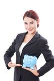 Szczęśliwy bizneswomanu mienia prosiątka bank Zdjęcia Stock
