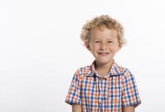 Szczęśliwy, blondynki chłopiec na białym tle zdjęcia stock