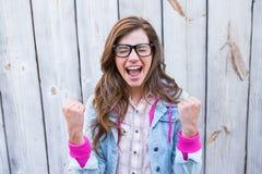 Szczęśliwy brunetka doping z rękami up Zdjęcia Royalty Free