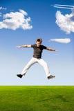szczęśliwy człowiek jumping Fotografia Royalty Free