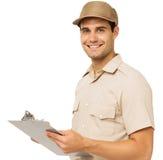 Szczęśliwy Deliveryman mienia schowek fotografia stock