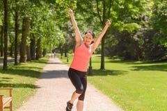 Szczęśliwy dysponowany kobieta doping, odświętność i zdjęcia royalty free