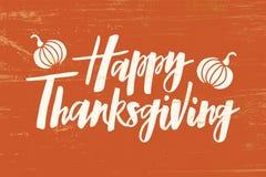 Szczęśliwy dziękczynienie - wręcza patroszonego literowanie typografii plakat royalty ilustracja
