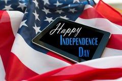 Szczęśliwy dzień niepodległości na pastylka komputeru osobistego flaga amerykańskiej zdjęcie stock