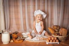 Szczęśliwy dziecko piekarz obraz royalty free
