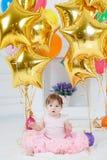 Szczęśliwy dziecko z balonami na jego pierwszy urodziny Obrazy Royalty Free