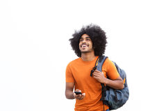 Szczęśliwy faceta odprowadzenie z telefonem komórkowym i torbą Fotografia Stock
