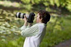 Szczęśliwy fotograf zdjęcia stock