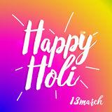 Szczęśliwy Holi typografii skład odizolowywający na kolorowym tle Fotografia Stock