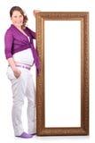 Szczęśliwy kobieta w ciąży stoi blisko ampuły ramy Obraz Stock