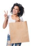 Szczęśliwy kobiety mienia torba na zakupy z pustą kopią astronautyczną i gestykuluje V znaka Obraz Royalty Free