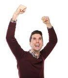 Szczęśliwy mężczyzna doping z rękami podnosić Zdjęcia Royalty Free