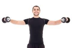 Szczęśliwy mężczyzna w czarnym sportswear robi ćwiczeniom z dumbbells iso Fotografia Royalty Free